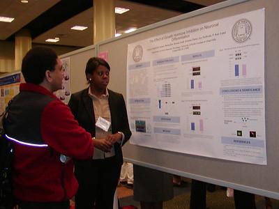 Dr. Ed Rosa-Molinar evaluates developmental biology poster (SDB Poster Judge) at ABRCMS 2004 meeting.