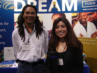 "Dr. Seth Ruffins (a scientist at Caltech and SDB member/poster judge) poses with one of the ""best posters in developmental biology"" winners at the ABRCMS 2006 meeting."