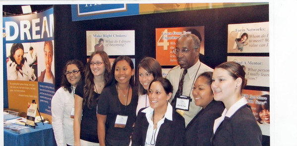 Dr. Howard Adams poses with students from Chaminade University of Honolulu.