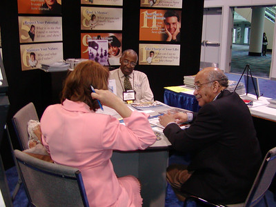 Dr. Howard Adams chats with booth visitors (including Dr. Adolphus Toliver from NIGMS/NIH.)