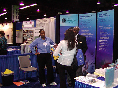 Ms. Kirsta Suggs, Dr. James Story and visitor at The Endocrine Society's booth.