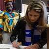 "U.S. Rep. Lori Trahan, right, signs a copy of ""Parsley's Big Adventure,"" in front of Beatrice Stevens during the African Community Center of Lowell's third anniversary event on Nov. 2. AARON CURTIS/LOWELL SUN"