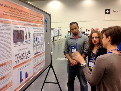 Francheska Mojica and Martin Rosario giving a poster presentation at the ACSM meeting
