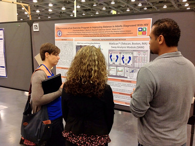 Francheska Mojica and Martin Rosario giving a poster presentation at the ACSM meeting