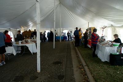 Exhibitors inside tent