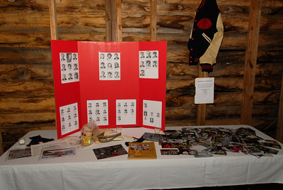 A Table of Memorabilia, which included: - Pictures of 25 of our  classmates, who are sadly no longer with us. - Pictures of our classmates, who served in the military.