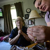 Kathy Krasnow, a registered nurse for BAYADA Home Health Care, shows Kathleen Leclaire how to measure out morphine to treat Andy's growing pain levels on May 19, 2016. Kristopher Radder / Reformer Staff
