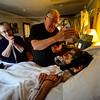 Father Timothy Campoli, from Blessed Sacraments from Greenfield, Mass., reads Andrew his Last Rites. Kristopher Radder / Reformer Staff