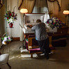 Before the closing of the casket, Kathleen Leclaire spends her final moments with Andrew on Sept. 2, 2016. Kristopher Radder / Reformer Staff