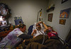 KRISTOPHER RADDER - BRATTLEBORO REFORMER Kathy Krasnow, a registered nurse for BAYADA Home Health Care, examines Andy Leclaire, while his 5-year-old granddaughter Lauren lays next to him during a visit on Monday, Dec. 21, 2015.