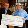 Tan Sri Lee presenting a cheque towards Gary Player foundation.