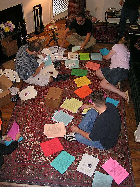 Grad students helping to pack the folders on Sunday before the conference at Cynthia's house.