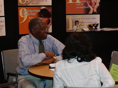 """ASHG 2006: FASEB/MARC booth in exhibit hall. Howard Adams meets with students in the """"Career Corner."""""""