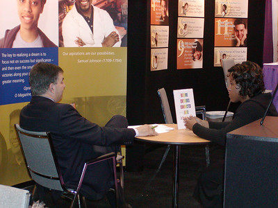 """ASHG 2006: FASEB/MARC booth in exhibit hall. Joe Tringali meets with students in the """"Career Corner."""""""
