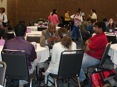 "ASHG 2006 - Career Center ""Meet 'n Greet"": Dr. Howard Adams counsels graduate students and postdocs."