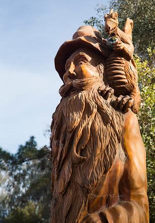 Wood carved man statute 8524