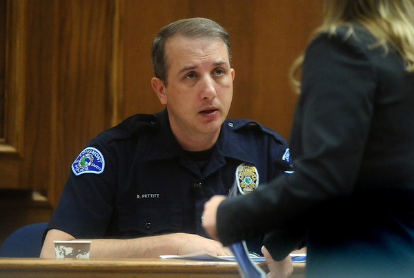 ABEYTA12.JPG ABEYTA12<br /> Longmont police officer Bruce Pettitt looks at photographs offered by prosecutor Katharina Booth during the trial of Joseph Abeyta, accused of murdering his friend, William Andrews, in north Boulder in January 2009.<br /> <br /> Photo by Marty Caivano/Camera/Oct. 15, 2009/