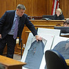 ABEYTA24.JPG ABEYTA24<br /> Detective David Spraggs of the Boulder Police Department, testifies about the clothing William Andrews was wearing when he was killed. The shift on the left was worn closest to the body. <br /> <br /> Photo by Marty Caivano/Camera/Oct. 20, 2009/