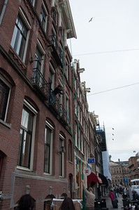 An example of the pulley system employed in homes and offices in Amsterdam. Most of the buildings have staircases too narrow for furniture and other goods, so they have crane or pulley rails extending from the top of the building to bring items in through the large windows in each floor beneath.
