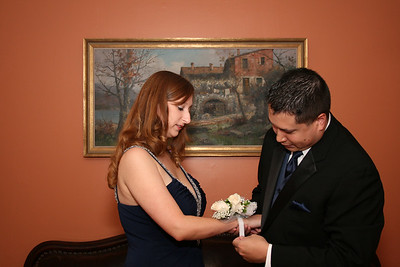 Putting the corsage on.