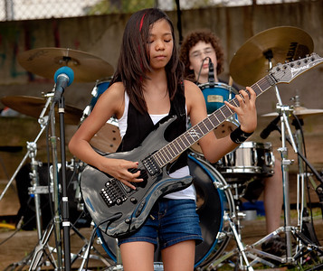 "Cheska plays guitar for The Fuzed, ""Northern Virginia's Hottest Young Rockers"" - Jake on the Drums"