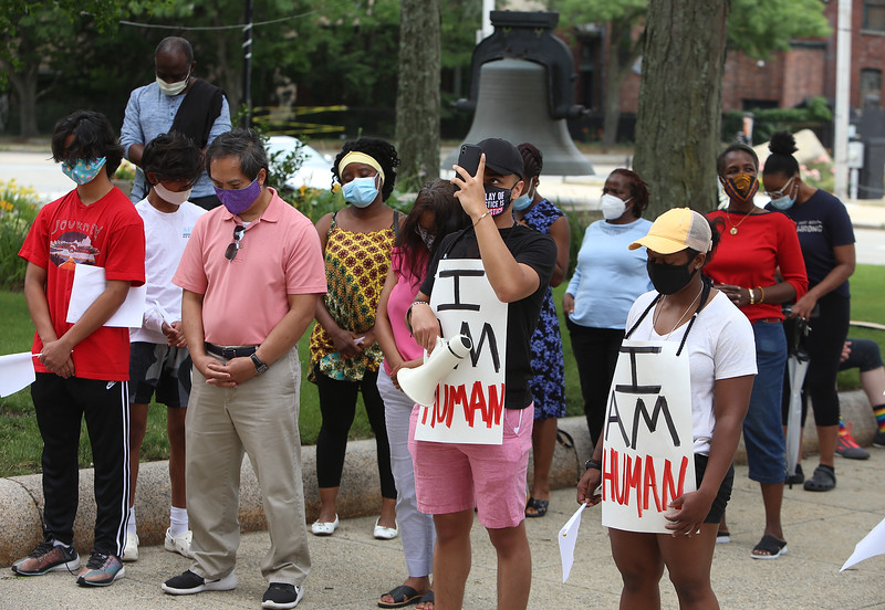 "African Cultural Association sponsors a Convoy Against Racial Injustice, in support of Black Lives Matter, on the Saturday that would have been the African Festival, had it not been cancelled due to COVID-19. City councilor Sokhary Chau (in pink shirt), and Miguel Nunes and his friend Kay Mede, both of Brockton, with ""I am human"" signs. (SUN/Julia Malakie)"