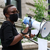 African Cultural Association sponsors a Convoy Against Racial Injustice, in support of Black Lives Matter, on the Saturday that would have been the African Festival, had it not been cancelled due to COVID-19. Mercy Amampiu of Lowell, who works for LCHC, introduces speakers. (SUN/Julia Malakie)