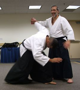 Smiling Sensei makes aikido look easy.