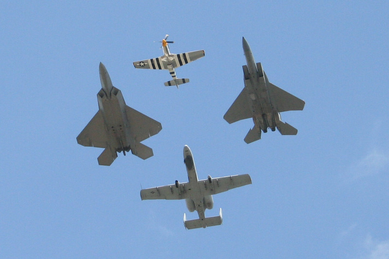 F-15, P-51 Mustang, A-10 Warthog, and F-22 Raptor flying together in formation, #89