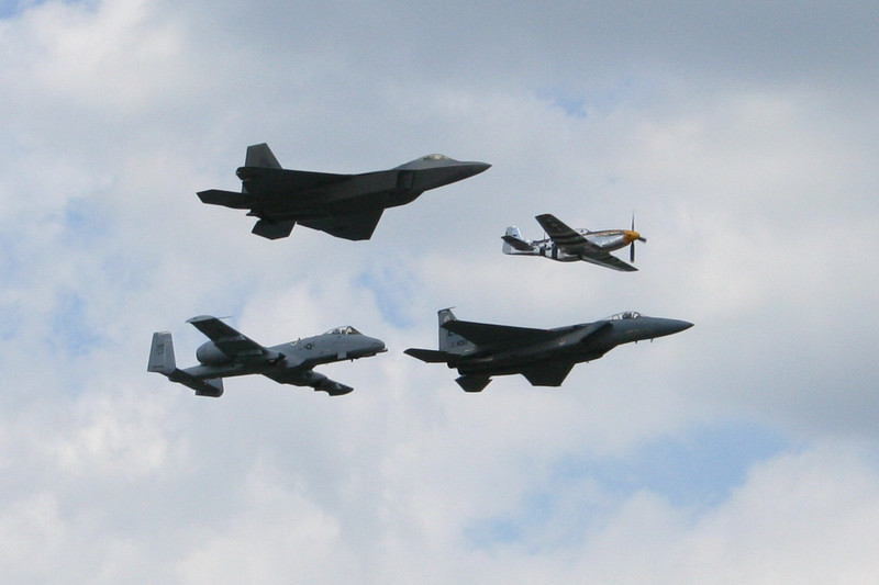 F-15, P-51 Mustang, A-10 Warthog, and F-22 Raptor flying together in formation, #100