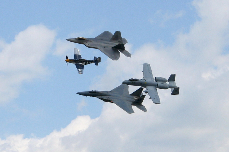 F-15, P-51 Mustang, A-10 Warthog, and F-22 Raptor flying together in formation, #96