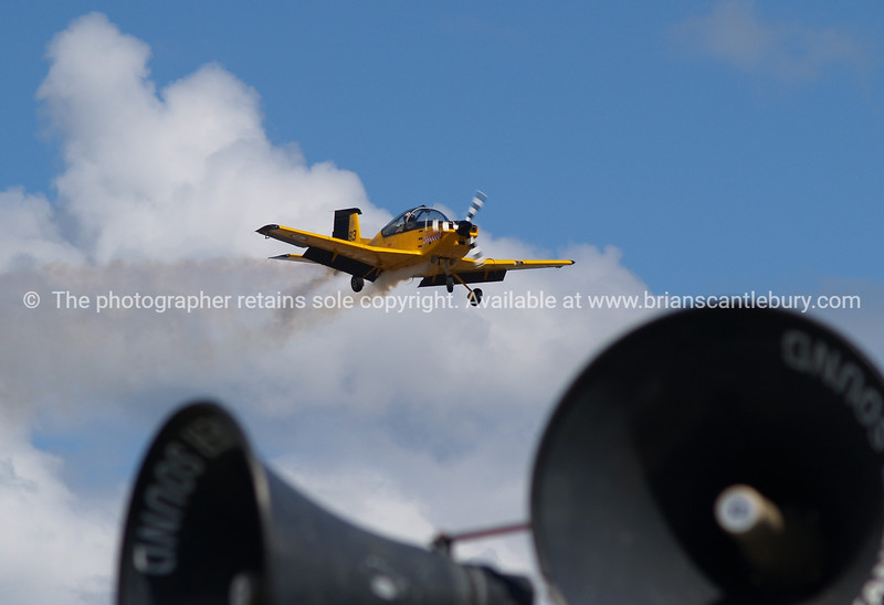 """Tauranga Airshow, 2008. New Zealand. A """" PAC CT4/E"""" flys over the field and public address speakers. Tauranga is New Zealands 5th largest city and offers a wonderfull variety of scenic and cultural experiences. ALSO SEE; <a href=""""http://www.blurb.com/b/3811392-tauranga"""">http://www.blurb.com/b/3811392-tauranga</a>"""