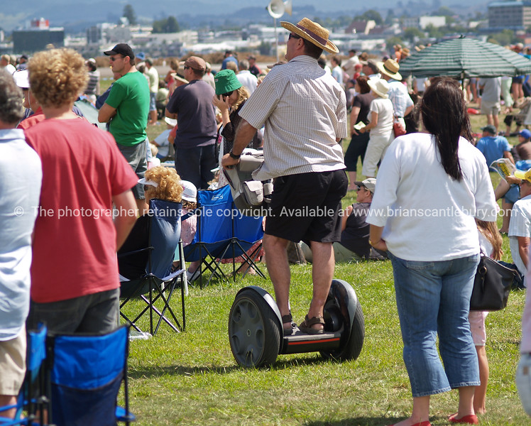 """Tauranga Airshow, 2008. New Zealand. The crowd and a Segway. Tauranga is New Zealands 5th largest city and offers a wonderfull variety of scenic and cultural experiences. ALSO SEE; <a href=""""http://www.blurb.com/b/3811392-tauranga"""">http://www.blurb.com/b/3811392-tauranga</a>"""