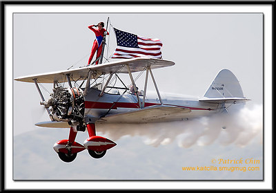 Margaret Stivers salutes to the crowd during aerobatic performance.