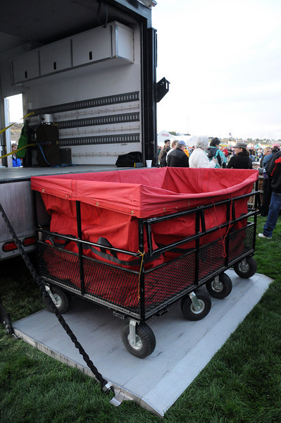 The large special shape Wells Fargo stagecoach requires a double-sized cart and a power lift to transport the envelope (balloon).