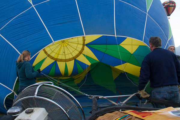 Inflating the balloon with a big fan.