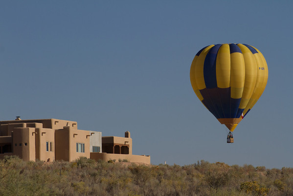 """Looking for a landing place.  This balloon was """"Balloon du Roy"""" from Cannes, France, and landed about 1/10th of a mile from our house.  (House in the picture is not our house.)"""