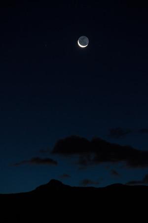 Moonrise over the Sandia Mountains.