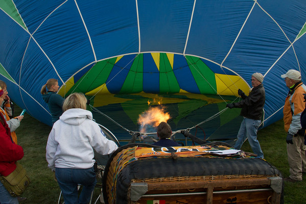 Firing up the burner to heat the air inside the balloon, and raise it to vertical.