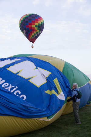 Helping the balloon inflate.