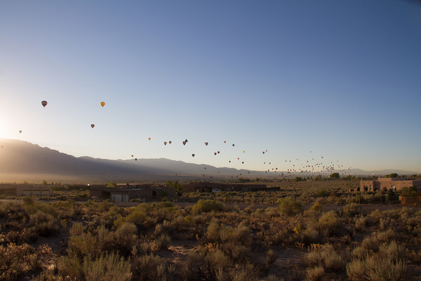 Balloons streaming northward toward our house from Balloon Fiesta Park about 5 miles away.