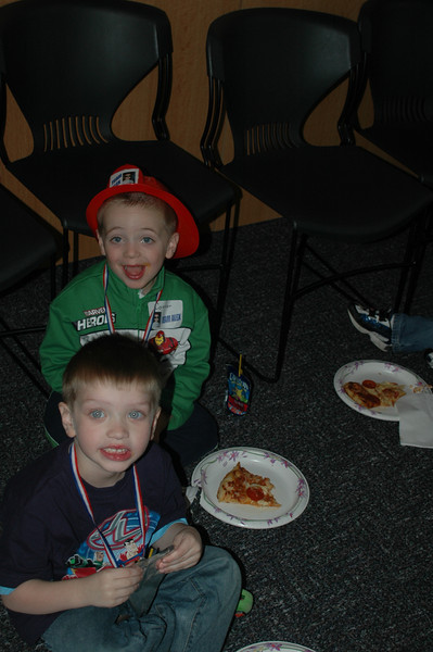 Eating pizza at Alex's party