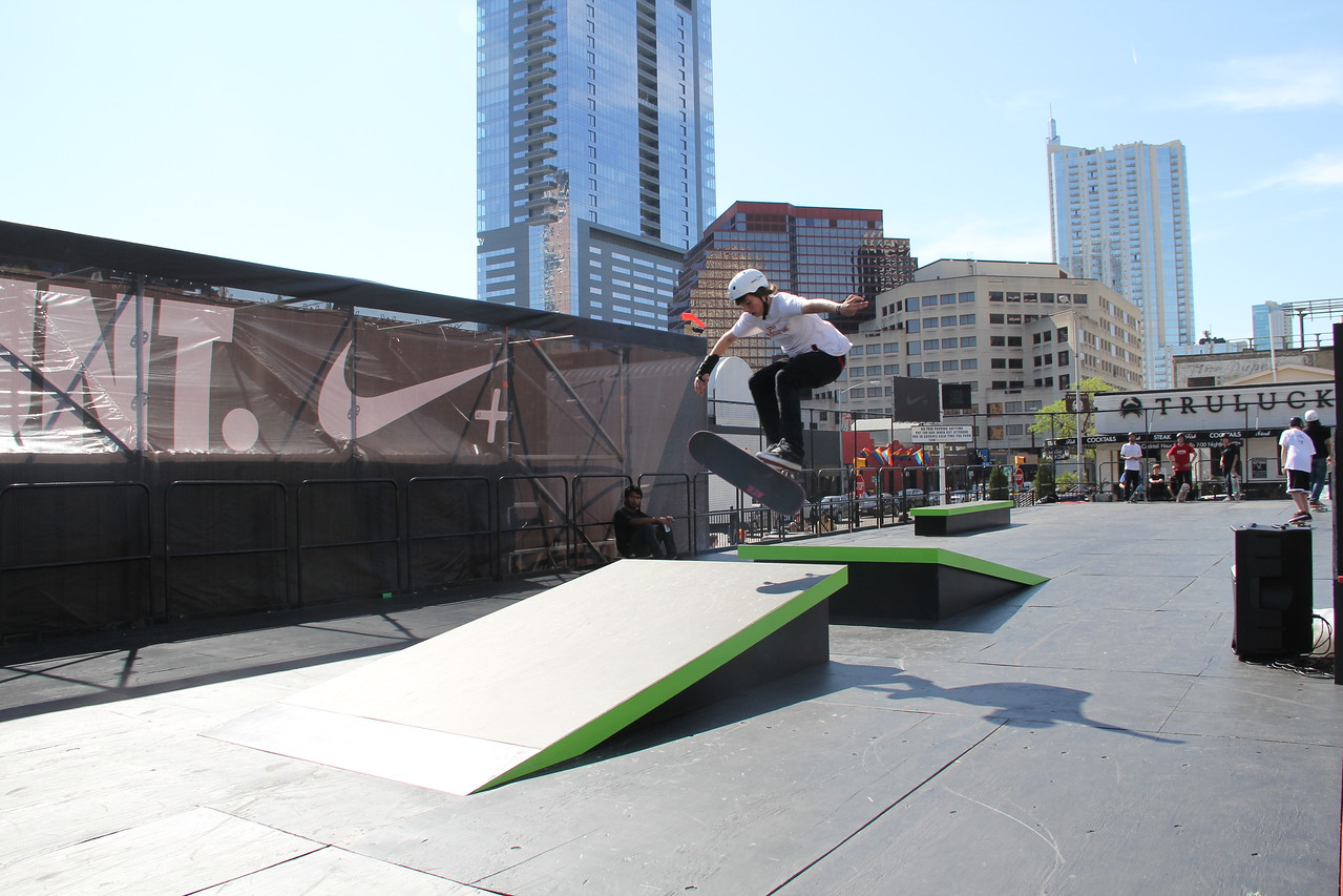 A skateboarder rides the ramp at Nike's SXSW sports courts.