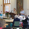 Sister Kristine Anne Harpenau, prioress, talks to the alumnae at their meeting.
