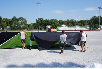 This is how we roll .. or really unroll. Another section of carpet is unrolled and laid into place.