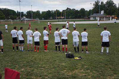 Alumni team watches the action on the field at the 10th Annual Alumni Soccer Game at Lutheran West