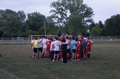 Alumni & team members gather after the 10th Annual Alumni Soccer Game at Lutheran West.
