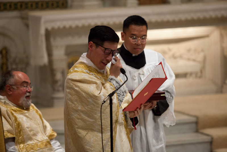 Fr. Alvin sheds a tear before presenting his mother with the gift of eternal salvation.