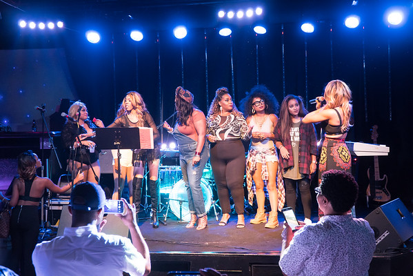 Amari On Stage with Singers