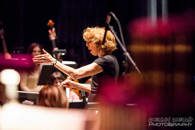President Composer and conductor Victoria Bond conducting a dress rehearsal for Anchorage Opera's world premier or Mrs. President.
